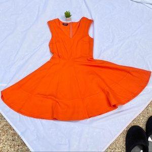 BEBE orange dress.